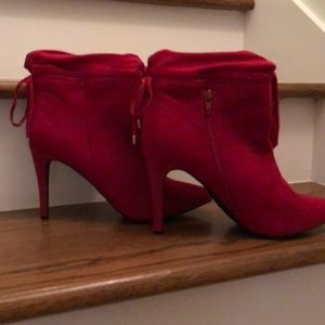 Red suede stiletto heeled boots